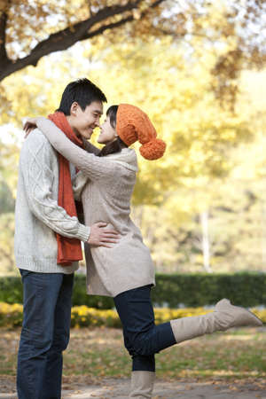 love at first sight: Young Couple Rubbing Noses in a Park in Autumn LANG_EVOIMAGES