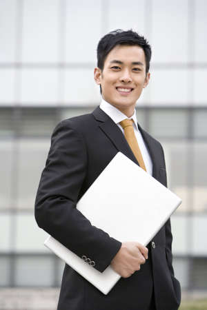 business: Businessman with laptop