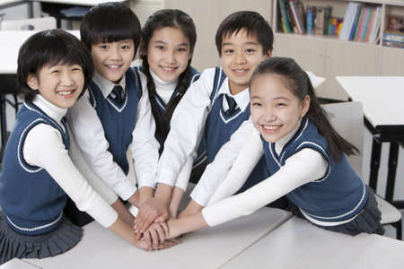 togther: Students huddled togther in the classroom