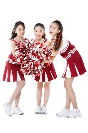 Portrait of three cheerleaders