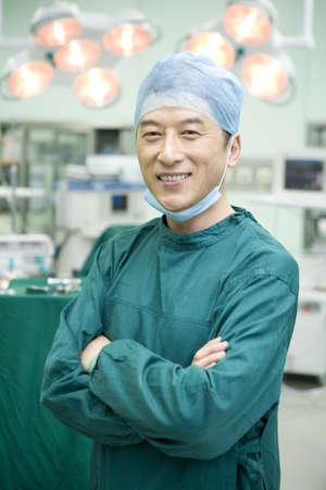 operating table: Portrait of a confident surgeon