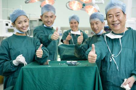 Portrait of a group of happy surgeons