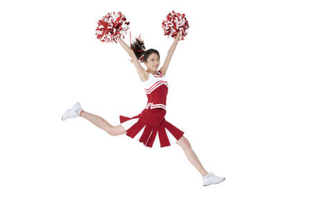 pom: Cheerleader in action with her pom-poms LANG_EVOIMAGES