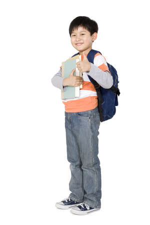 cheer full: A young boy holding books and giving a thumbs up