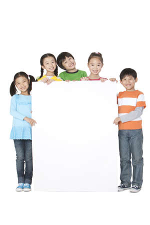 multi age: A group of classmates holding up a blank sign