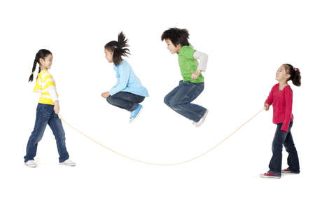 multi age: A group of friends play jump rope together