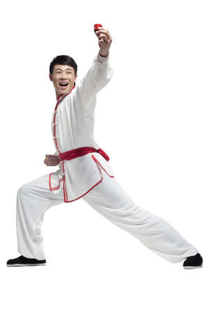 Excited Man In Traditional Chinese Clothing Holding up Cup