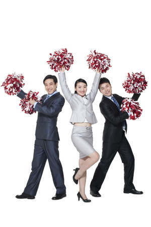 A team of businesspeople cheering with pompoms
