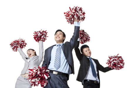 out of context:  A team of businesspeople cheering with pompoms