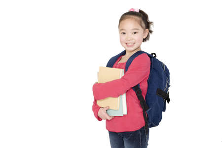 A young girl holding her school books LANG_EVOIMAGES