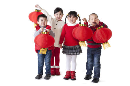 Four Chinese children holding lanterns aloft