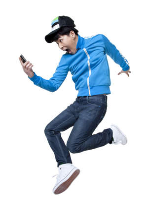 legs wide open: excited man jumping up with phone