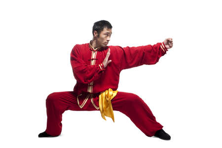 punched out: Focused Man Doing Martial Arts in Chinese Clothing