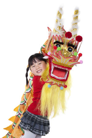 Cute Chinese girl holding Chinese dragon