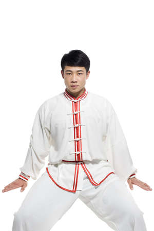 Man in Traditional Chinese Clothing Doing Taijiquan LANG_EVOIMAGES