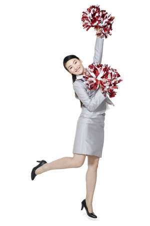 A businesswoman cheering with pompoms LANG_EVOIMAGES