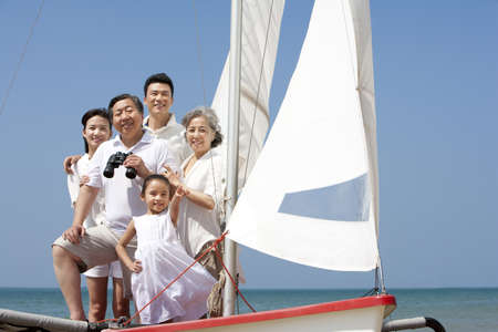 Happy Family On a Sailboat LANG_EVOIMAGES