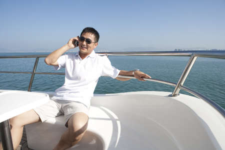 one mature man only: Carefree Man Talking on the Phone While Yachting