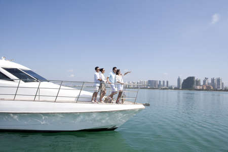Friends Having Fun on a Yacht LANG_EVOIMAGES