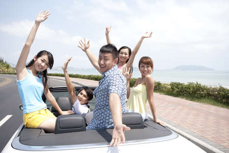 Friends Having Fun in a Convertible LANG_EVOIMAGES