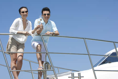 Toasting Champagne on a Yacht