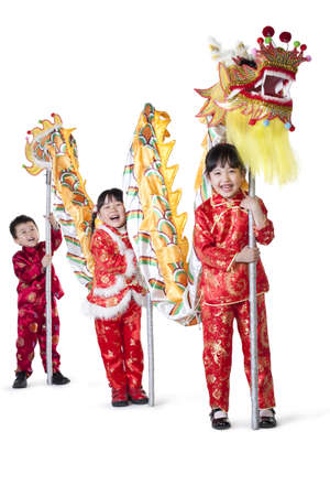 Three Chinese children holding Chinese dragon