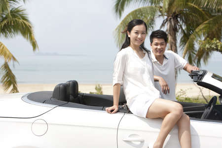 Happy Couple Posing In a Convertible