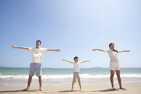 Family Stretching Out Arms on the Beach LANG_EVOIMAGES