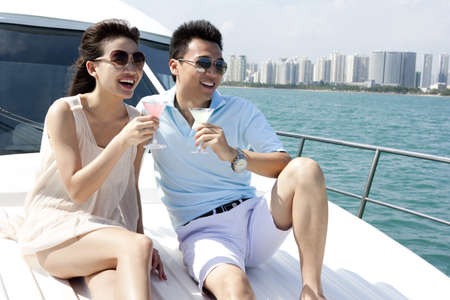 Couple Relaxing on a Yacht LANG_EVOIMAGES