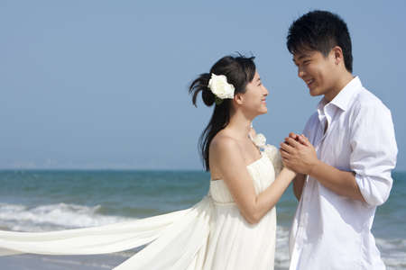 over the edge: Happy Newlyweds on the Beach