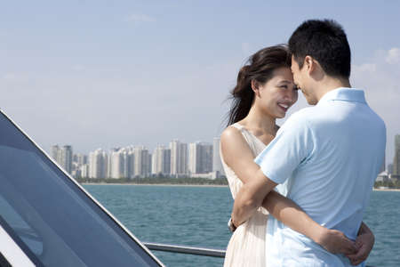 over the edge: Couple Embracing on a Yacht