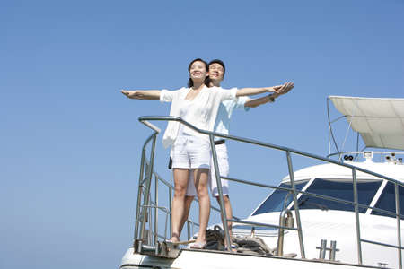 Happy Couple on a Yacht LANG_EVOIMAGES