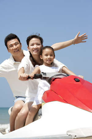 Happy Family Riding a Jet Ski Together