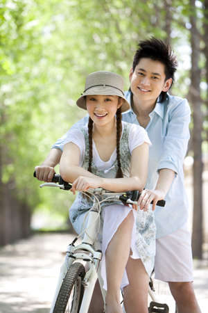 Happy Young Couple at the Park LANG_EVOIMAGES
