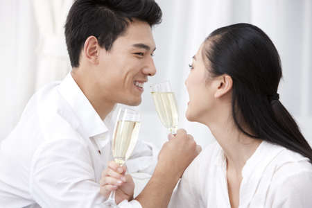 Happy young couple drinking champagne