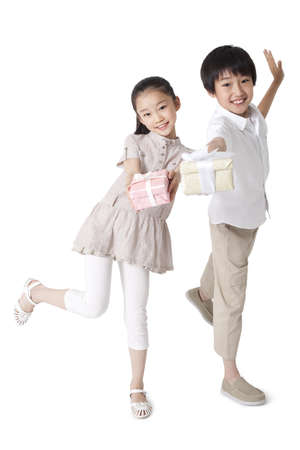 Cute Siblings Holding Gifts LANG_EVOIMAGES