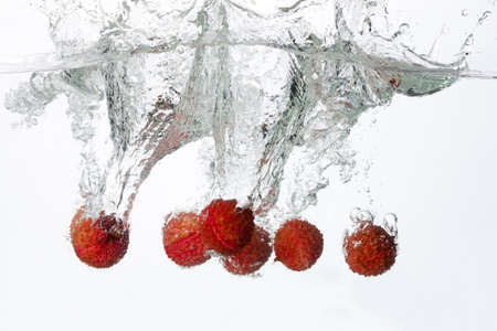 Lychee Splashing into Water LANG_EVOIMAGES
