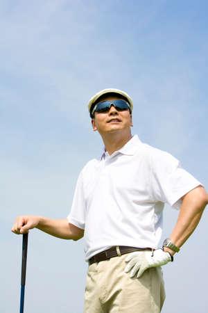 outdoor sport: Portrait of a male Golfer