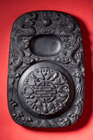 lucky charm: Chinese calligraphy ink stone LANG_EVOIMAGES
