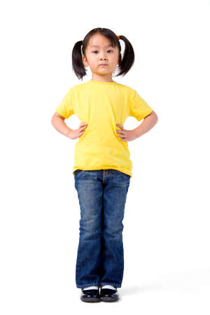 disbelief: Little girl stands with her hands on her hips