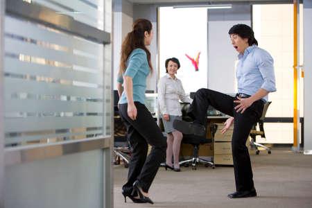 kick around: Office workers kick a shuttlecock around on break