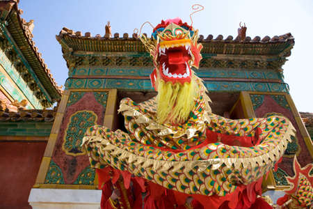 Lion dancing in front of traditional building