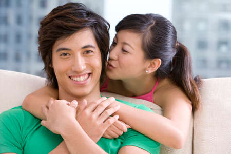 Asian couple holding each other