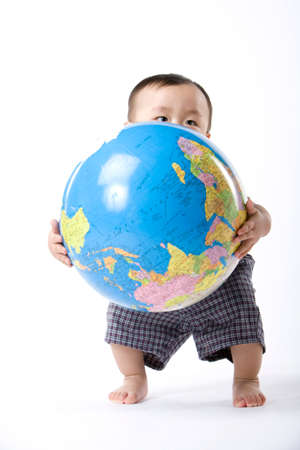 Infant with globe LANG_EVOIMAGES