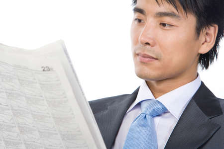 Young Businessman reading newspaper