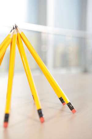 Pencils propped up in a pyramid shape