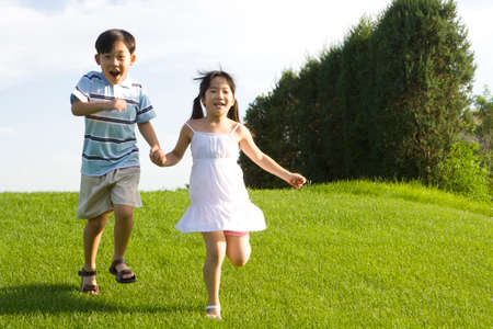 only boys: Children holding hands and running outdoors