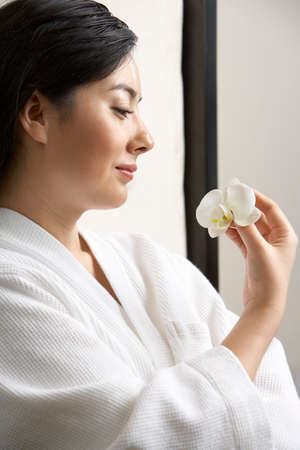 oriental bathrobe: Woman with an orchid at a spa LANG_EVOIMAGES