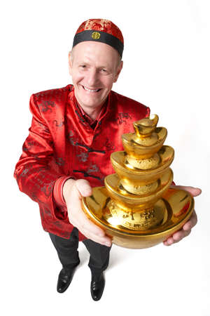 tang: A man holds gold as a symbol of wealth and prosperity for Chinese New Year
