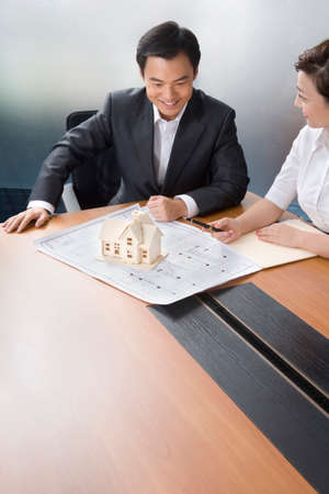 dollhouse: Businessmen with house model